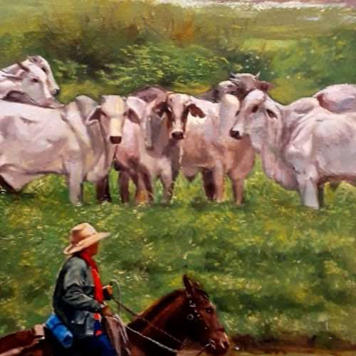 Venezuelan grasslands scenery with cows and a llanero riding his horse, oil painted on a Venezuelan banknote.