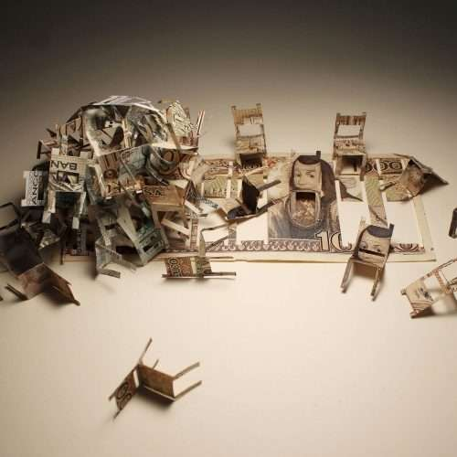 Installation of small chairs made with cut and folded Mexican banknotes.