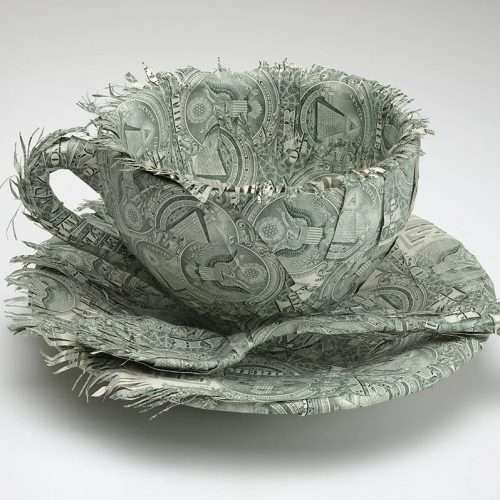 Teacup and saucer sculpture made with US currency (after Meret Oppenheim's Object, Le Déjeuner en Fourrure, 1936).
