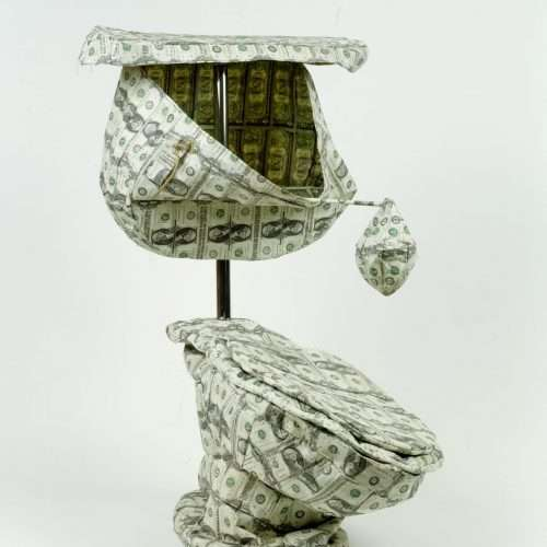 Sculpture of a toilet made with sewn US currency, wood, metal and velcro (after Claus Oldenburg's Soft Toilet, 1966).